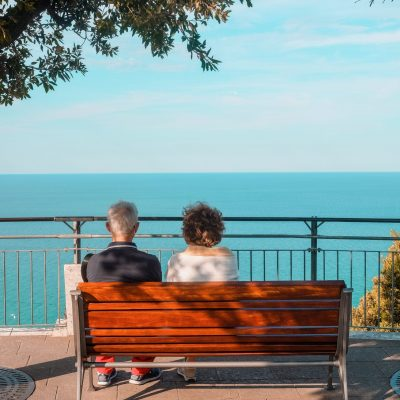 people-sit-on-red-bench-and-admire-the-view